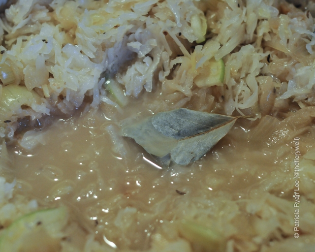 Add sauerkraut to deglaze pan, then add caraway seeds and bay leaf.